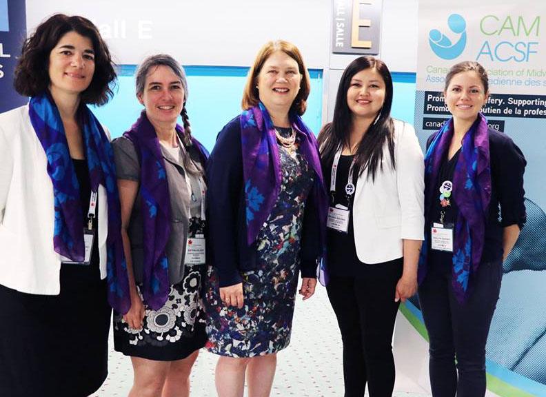 CAM Executive Director, Tonia Occhionero, and CAM President Katrina Kilroy stand with then Minister of Health Jane Philpott and NACM Co‑Chairs Melissa Brown and Evelyn George (2017), while wearing the CAM/NACM scarf which represents the CAM‑NACM collaboration and serves as a commitment to this relationship into the future.
