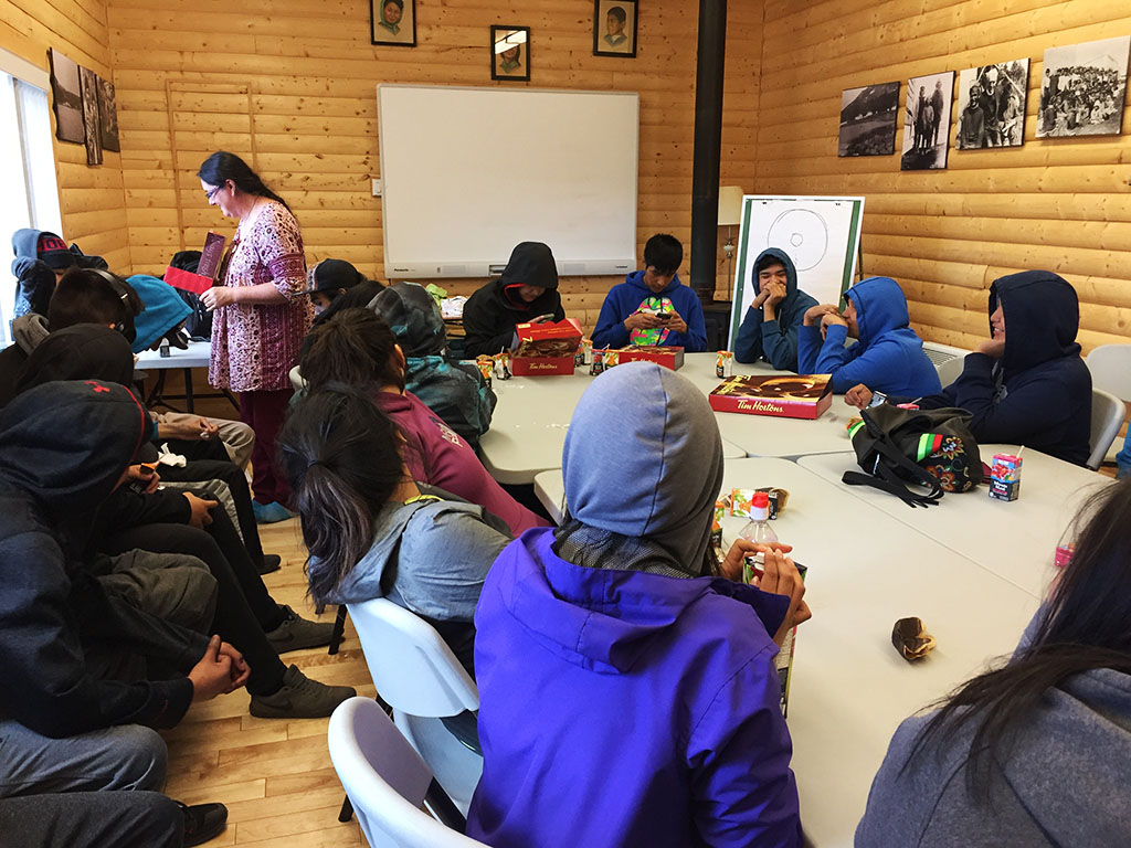 Carol Couchie gives workshop on reproductive health to teenagers in Natuashish, NL.