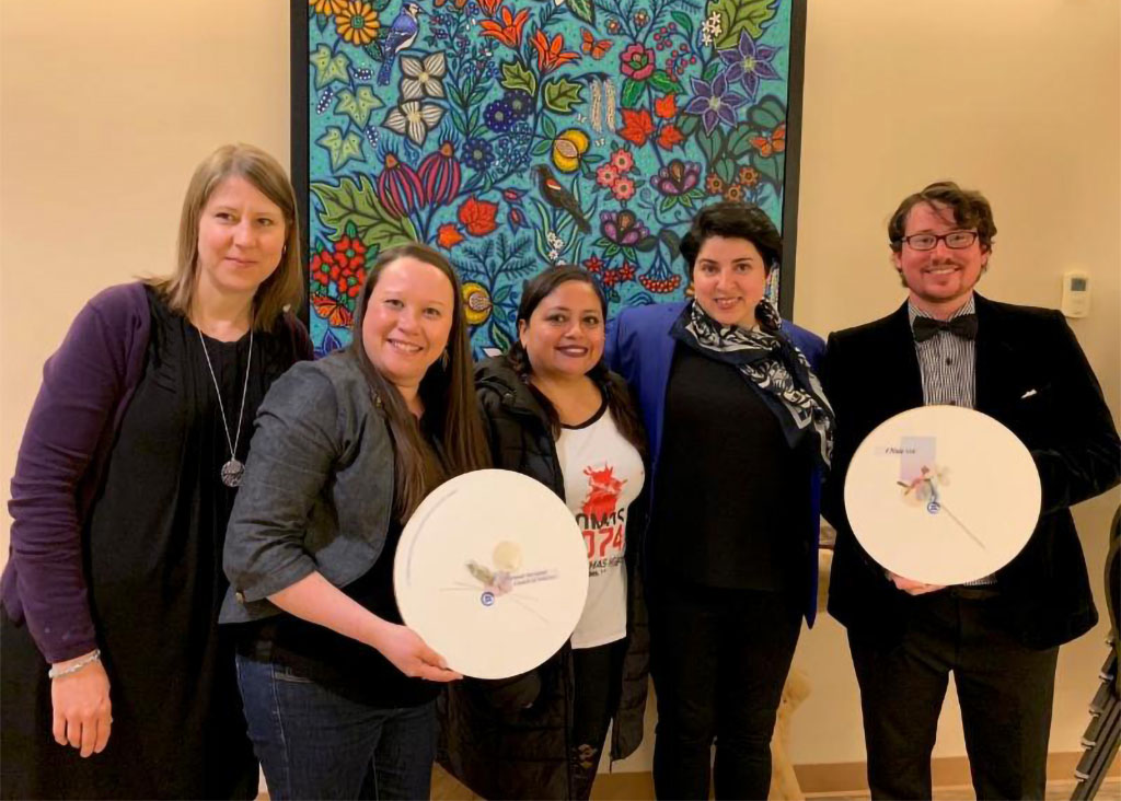 NACM and Clinic 554 receive beautiful plaques from Inter Pares.
